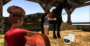 Playing my guitar to Taelor and Cocoa